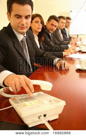 Conference call set up during a business meeting.