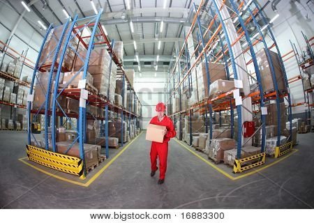 worker in red uniform with box in the warehouse in fish-eye lens