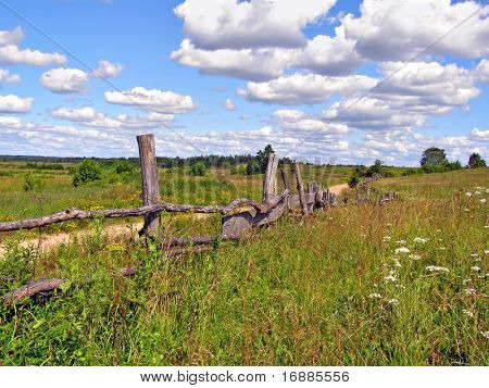 old fence on field near roads