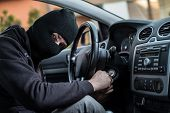 Auto Thief Trying To Start Car With Screwdriver In Ignition poster