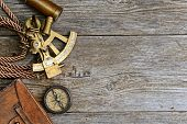 vintage still life with compass,sextant and spyglass poster