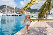 Постер, плакат: Woman tourist walking in Philipsburg harbor St Maarten popular port of call for cruise ship travel