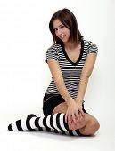 image of knee-high socks  - Sexy girl in funny socks posing on her knees - JPG