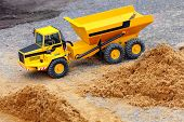 stock photo of dumper  - Yellow dumper on a road building - JPG