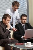 picture of people work  - Three business men working together on laptop in the office - JPG
