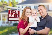 Happy Young Military Family in Front of For Sale Real Estate Sign and New House. poster