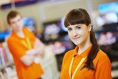 female seller assistant in hardware shop poster