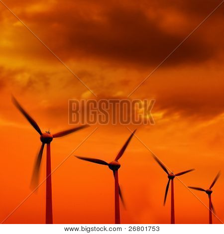 wind turbine in a row over orange background