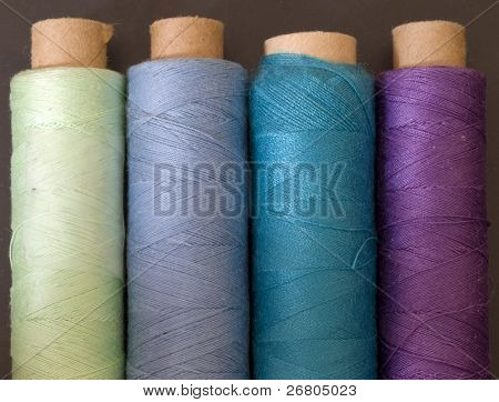 colorful bobbins in line