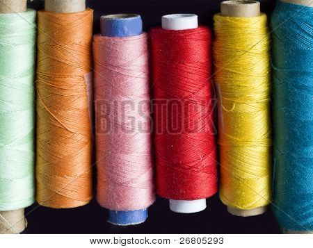 colorful bobbins in the line