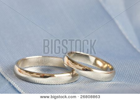 rings on blue sateen
