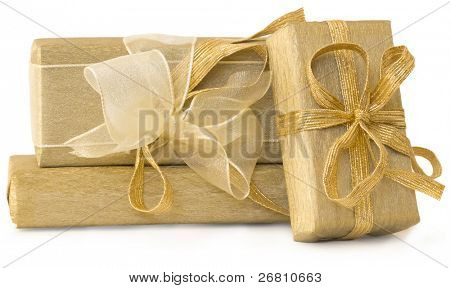 golden gift boxes with beautiful bows isolated on white
