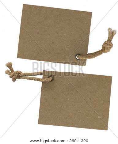 two cardboard corrugated paper labels with strings isolated on the white background