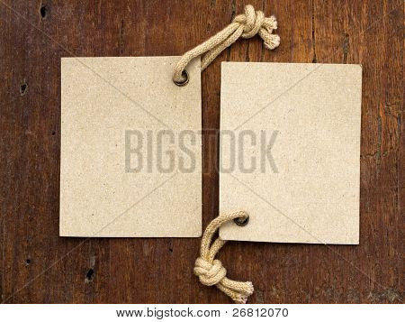 two labels on the wooden background