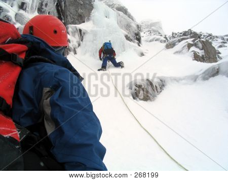 Ice Climbers In Scotland