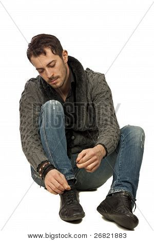 Young Man Lacing His Shoes