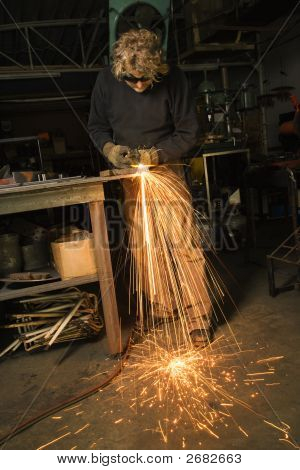 Metalsmith Creating Sparks.