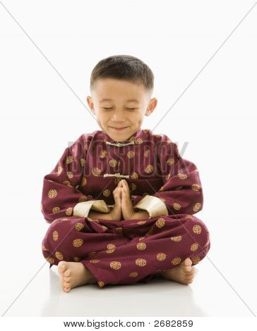 Asian Boy Meditating.