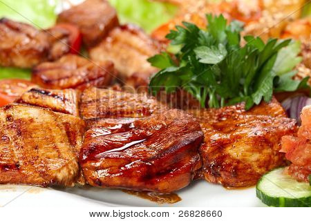 barbecue with sauce and vegetables