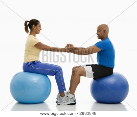 Man And Woman Exercising.