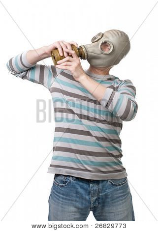 Man trying to remove a gas mask from his head against white background