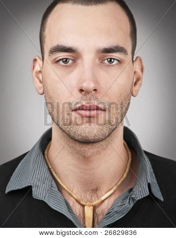 Portrait of handsome young man looking at camera