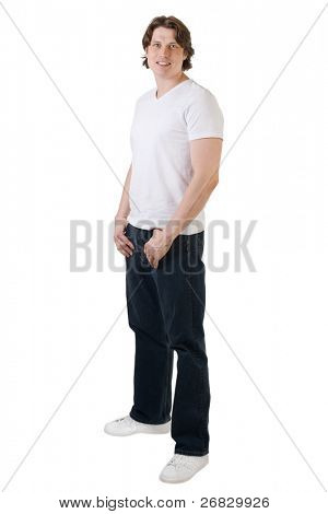 Handsome muscular man wearing white t-shirt, blue jeans and sneakers against white background