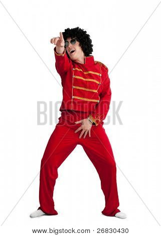Screaming happy man wearing red costume and black wig over white background