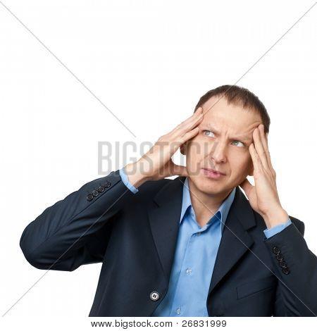 Worried businessman having a headache against white background