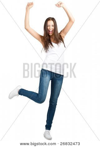 Full length portrait of happy excited girl jumping with arms extended . Over white background
