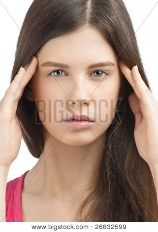 Close-up portrait of young beautiful woman having a headache against white background