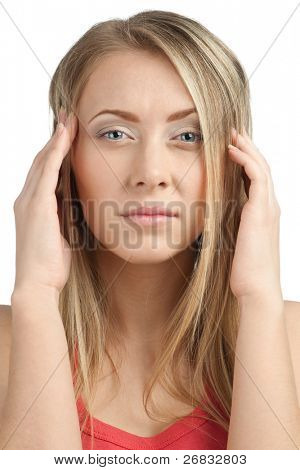 Close-up portrait of young woman having a headache, against white background