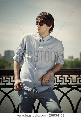 Portrait of handsome young man wearing sunglasses outdoors