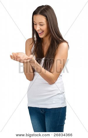 Portrait of a happy young casual woman showing something on the palms of her hands, against white background