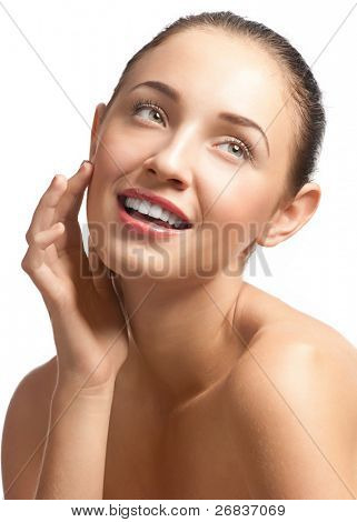 Close-up portrait of young beautiful woman with perfect healthy skin touching her face, isolated on white background