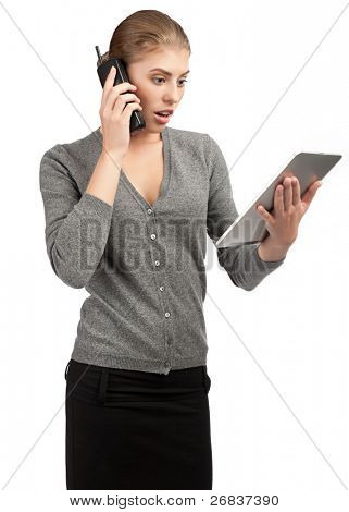 Surprised business woman talking on telephone and using tablet computer. Isolated on white background