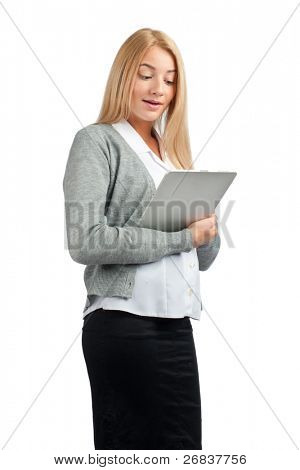 Attractive business woman using tablet computer and looking surprised