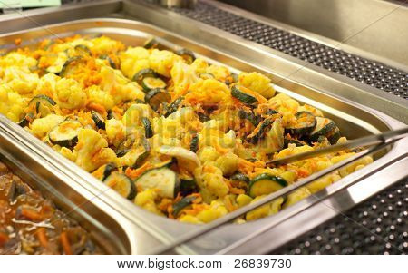 Prepared vegetables in gastronomical container, narrow focus