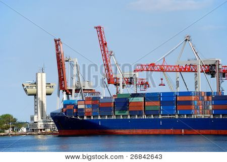 The cargo ship with containers unloads in port