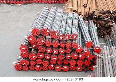 Bunch of new pipes on a warehouse platform