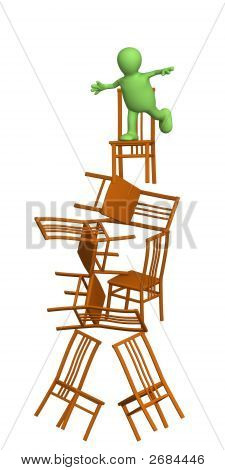 3D Puppet, Balancing At Top Of A Pyramid From Chairs