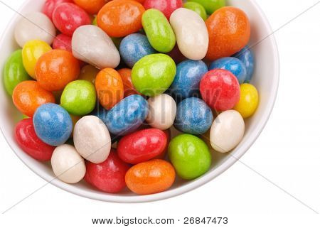 Multicolored sweets covered with glaze on a plate