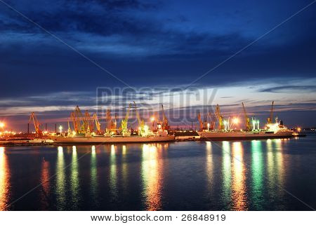 night view of the industrial port with cargoes and ship