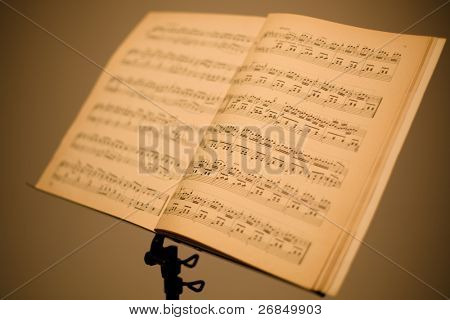 music stand with piano notes