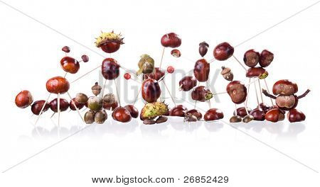 group of little manikin made of chestnuts isolated on white