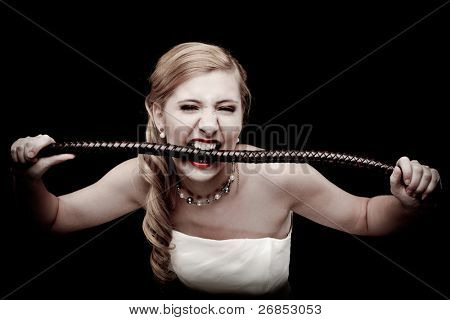 Portrait of blond haired girl biting a whip