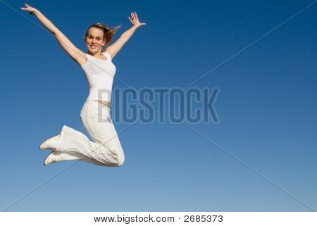 Happy Smiling Woman Jumping
