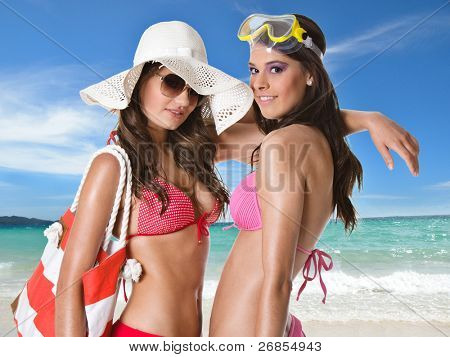 Young happy women at the beach