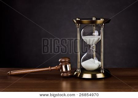 Gavel and Hourglass on dark