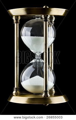 Hourglass against a black background.